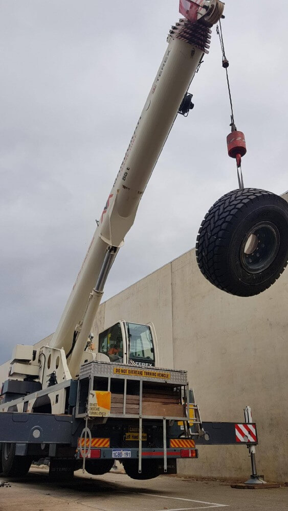 Our crane lifting a tyre
